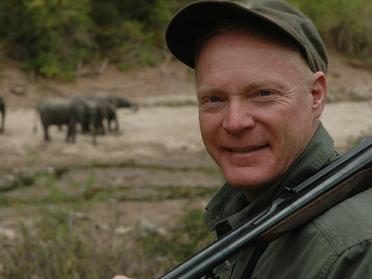 Craig Boddington in Zambezi Valley with elephants in background.