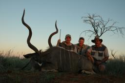 A spectacular greater kudu, taken in Namibia by Jim Morey, left, with professional hunter Dirk de Bod, right.  This is a big bull with incredibly tall horns—but even this amazing kudu doesn't reach the magical 60-inch mark.