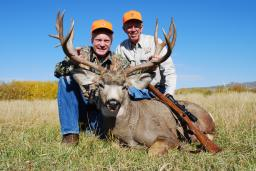 """The .264 Winchester Magnum was conceived as an ideal """"western"""" hunting cartridge, ideal in open country. Although it hasn't been popular for many years, it's still a great mule deer cartridge. Boddington's .264 accounted for this fine Wyoming buck in 2007."""