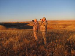 Boddington and guide Ken Jensen glassing typical prairie habitat. It looks flat, but there are deceptive folds and gullies. You think you see it all…but you never really do.