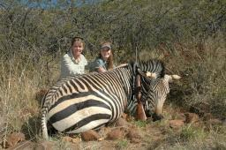 Donna and Brittany Boddington with Brittany's huge mountain zebra, taken in Namibia with the little 7mm-08.  Shot placement counts, of course, but this little cartridge performs much better than its mild recoil and paper ballistics seem to suggest.